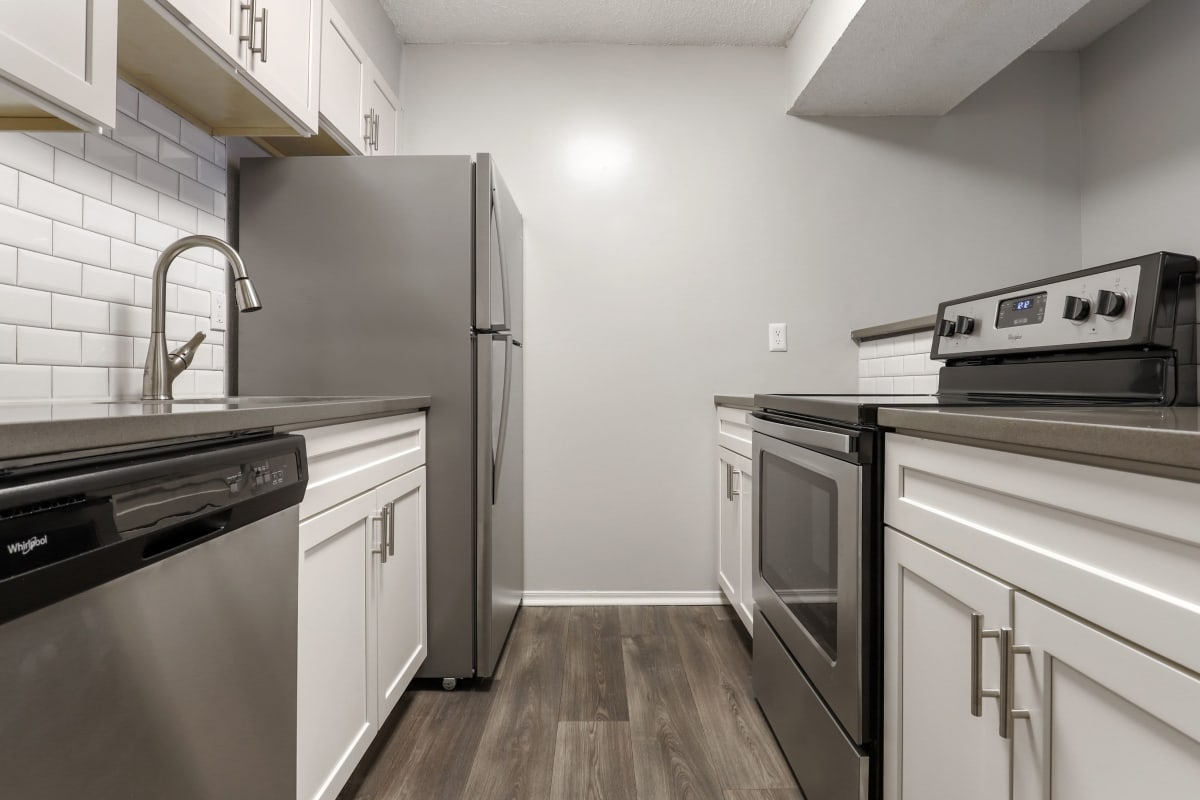 Kitchen with stainless steel appliances at The Alcove in Smyrna, Georgia