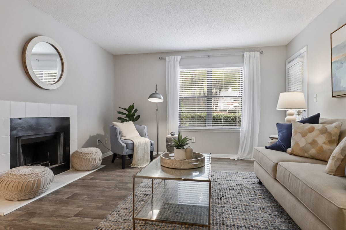 Living room with wood style flooring at The Alcove in Smyrna, Georgia