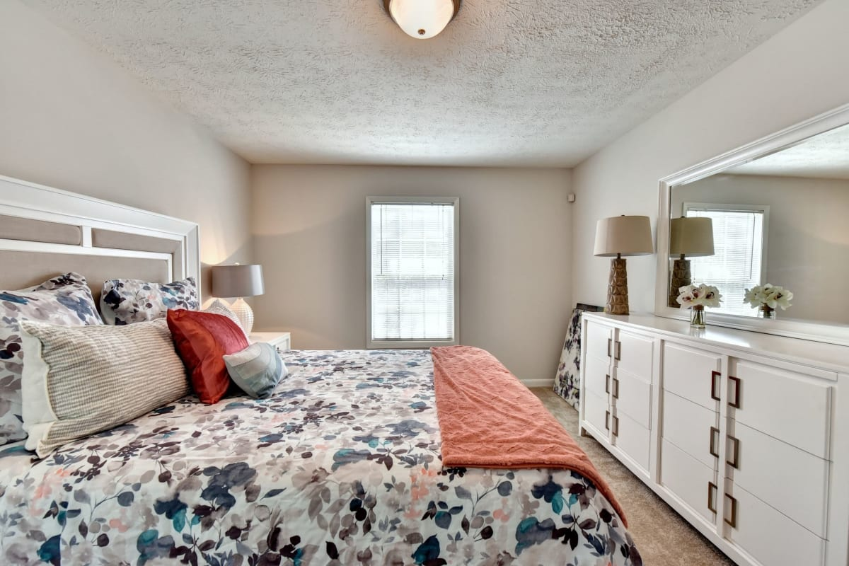 Bedroom with a large window at Fields at Peachtree Corners in Norcross, Georgia
