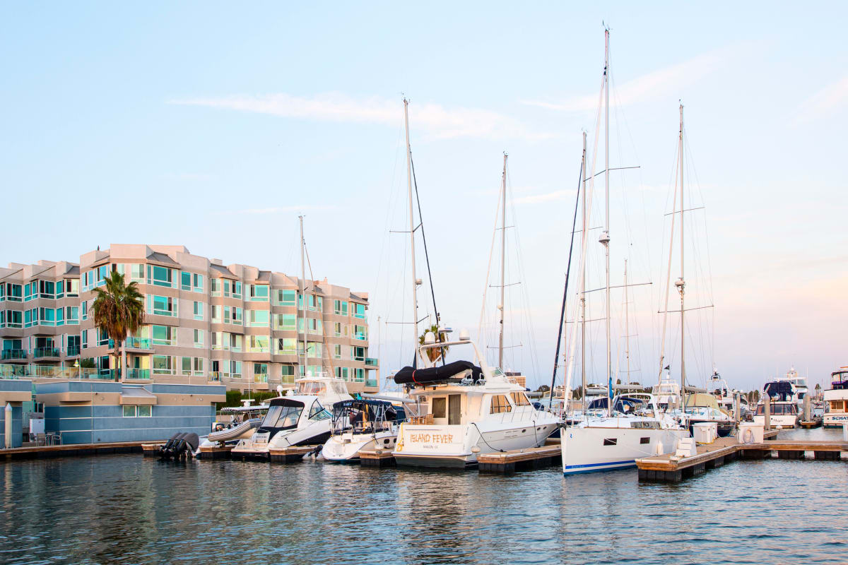 Boats moored in slips at the marina at Esprit Marina del Rey in Marina del Rey, California