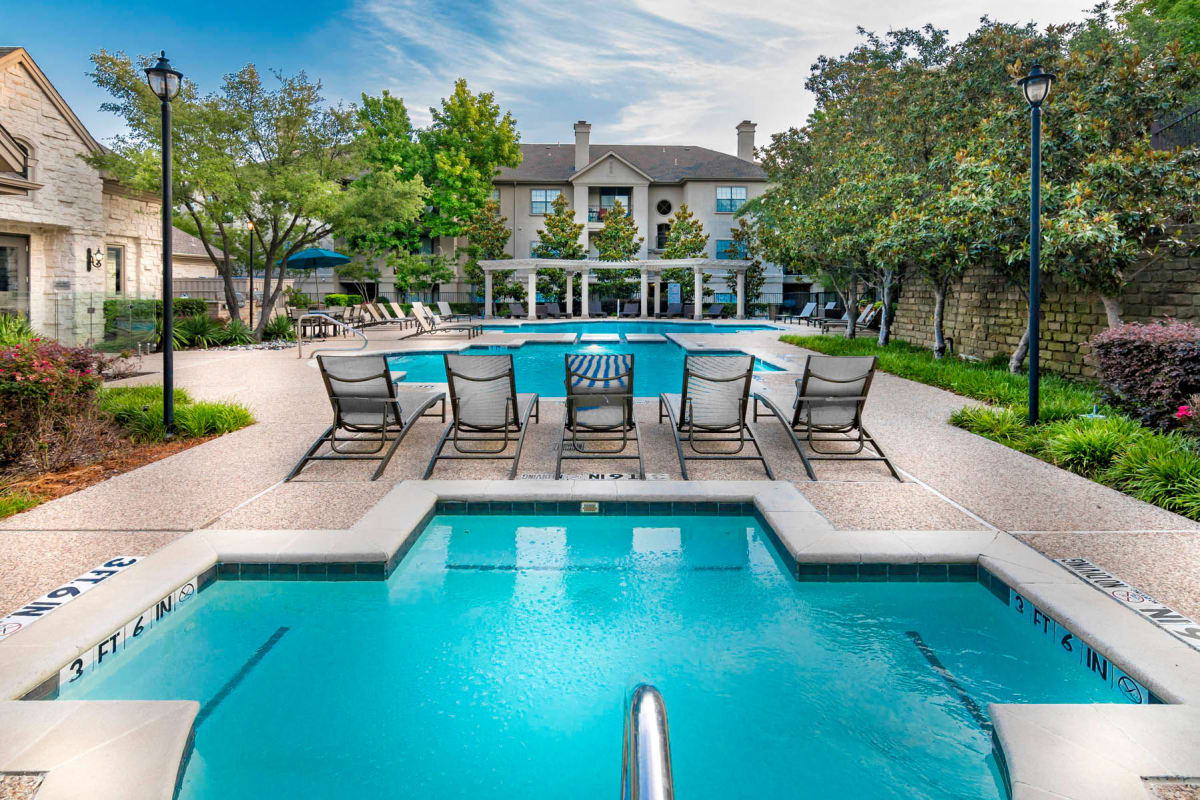 Chaise lounge chairs on the sundeck around the pool at Hyde Park at Montfort in Dallas, Texas