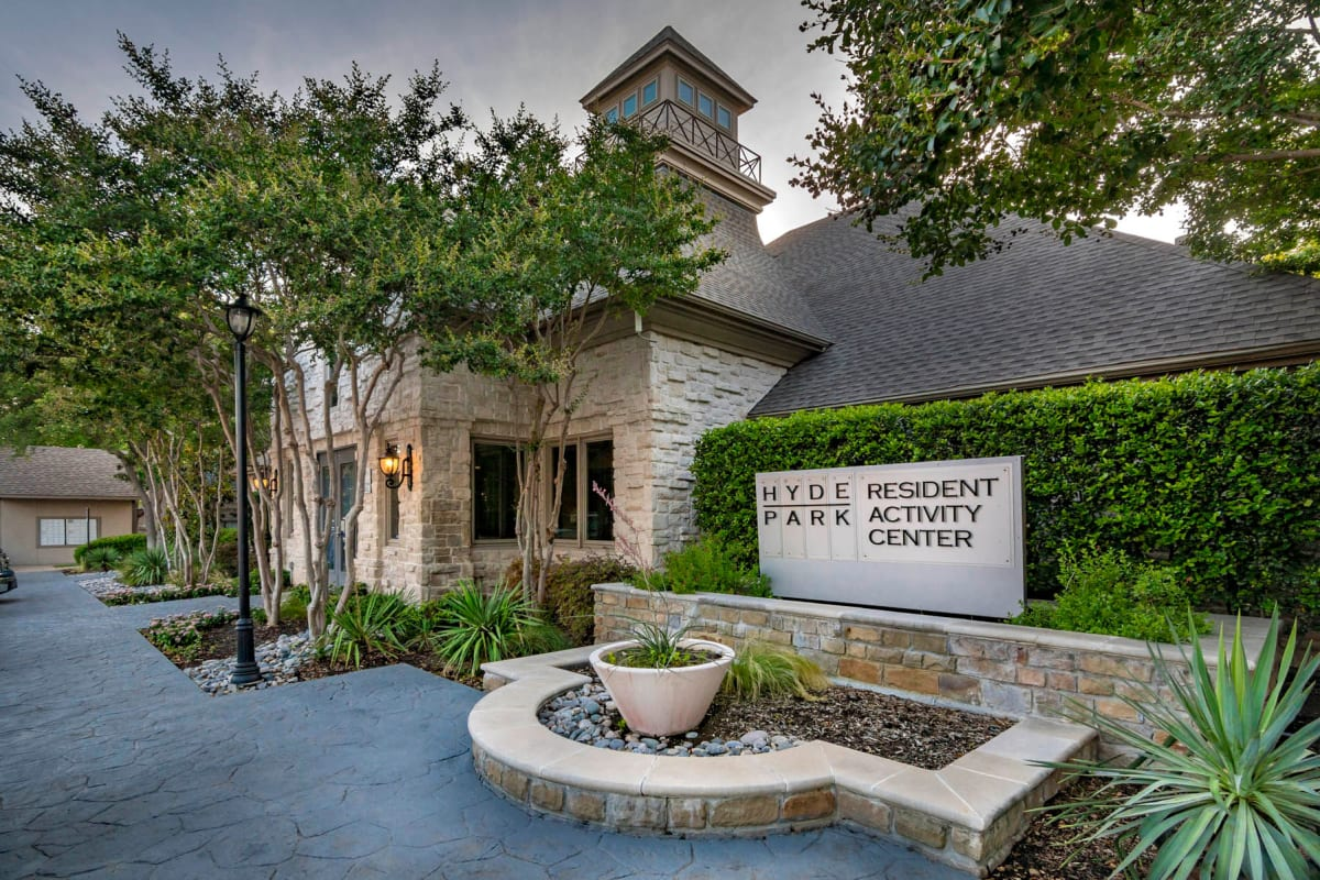 Exterior view of the resident clubhouse at Hyde Park at Montfort in Dallas, Texas