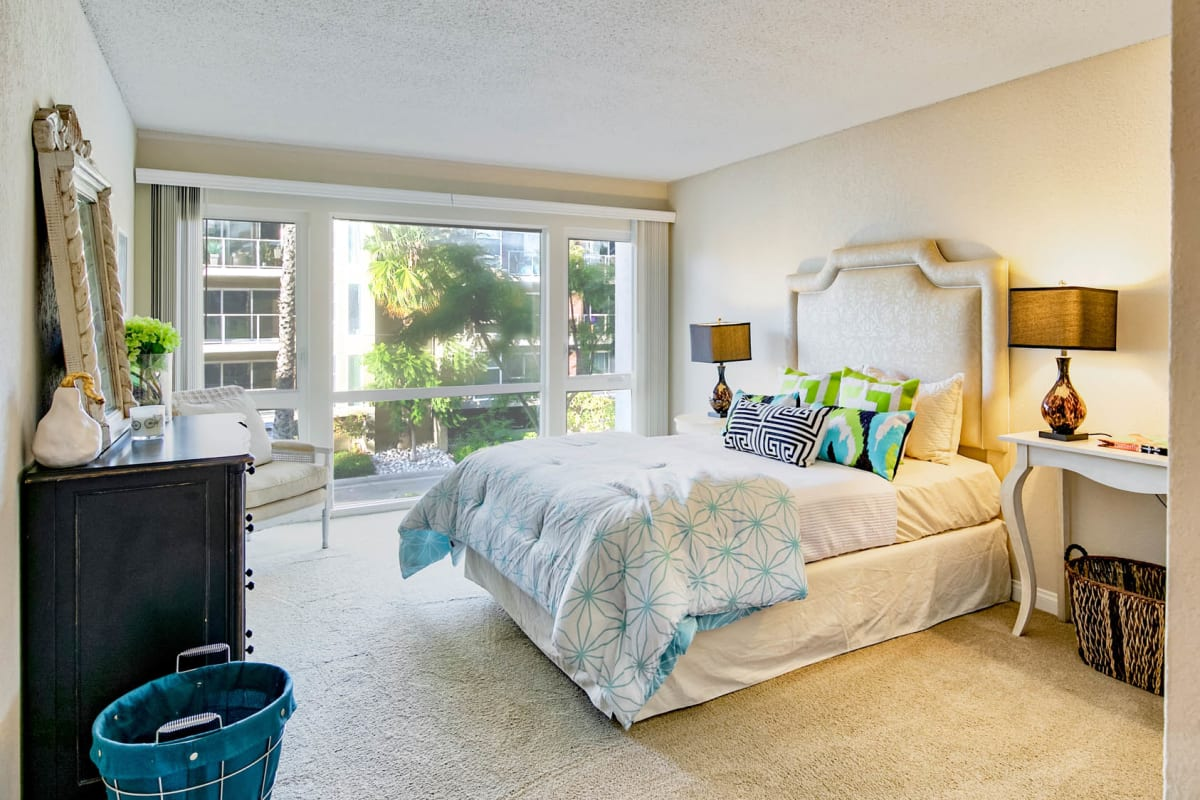 Plush carpeting in the primary bedroom of a model apartment at The Tides at Marina Harbor in Marina Del Rey, California