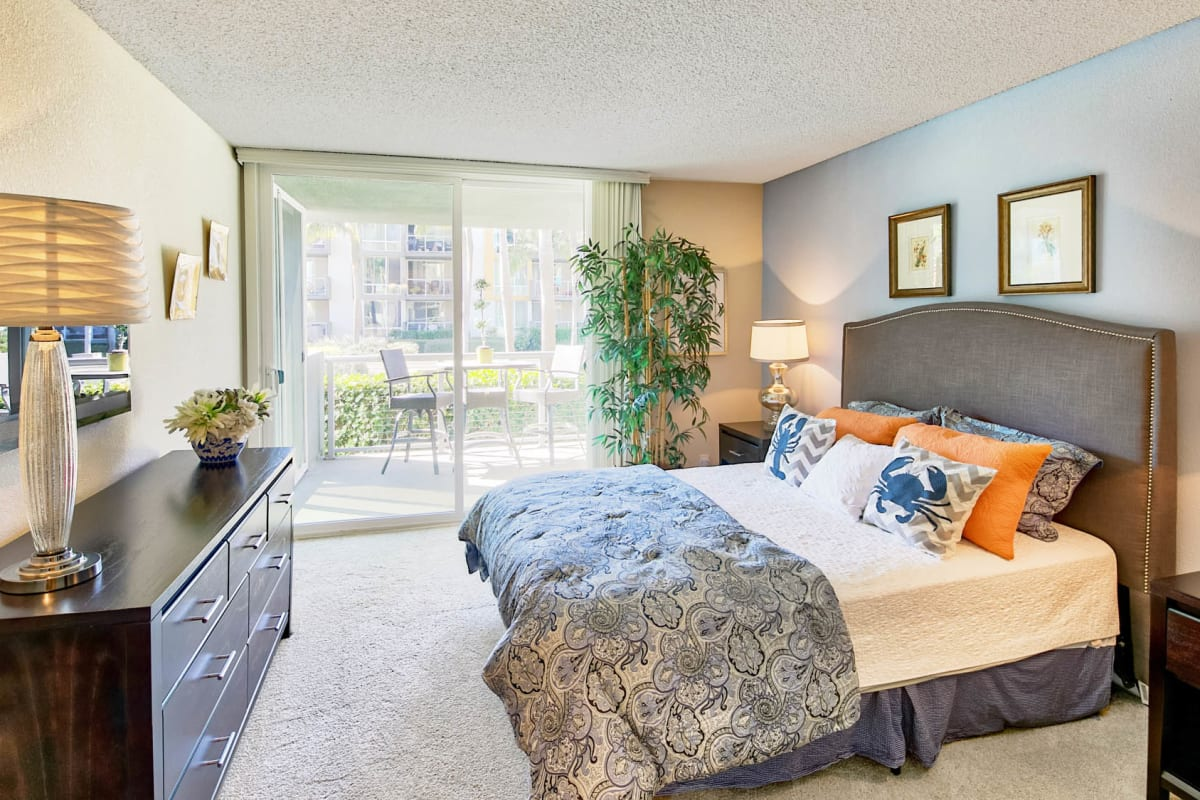 Model home's primary bedroom with plush carpeting at Waters Edge at Marina Harbor in Marina Del Rey, California