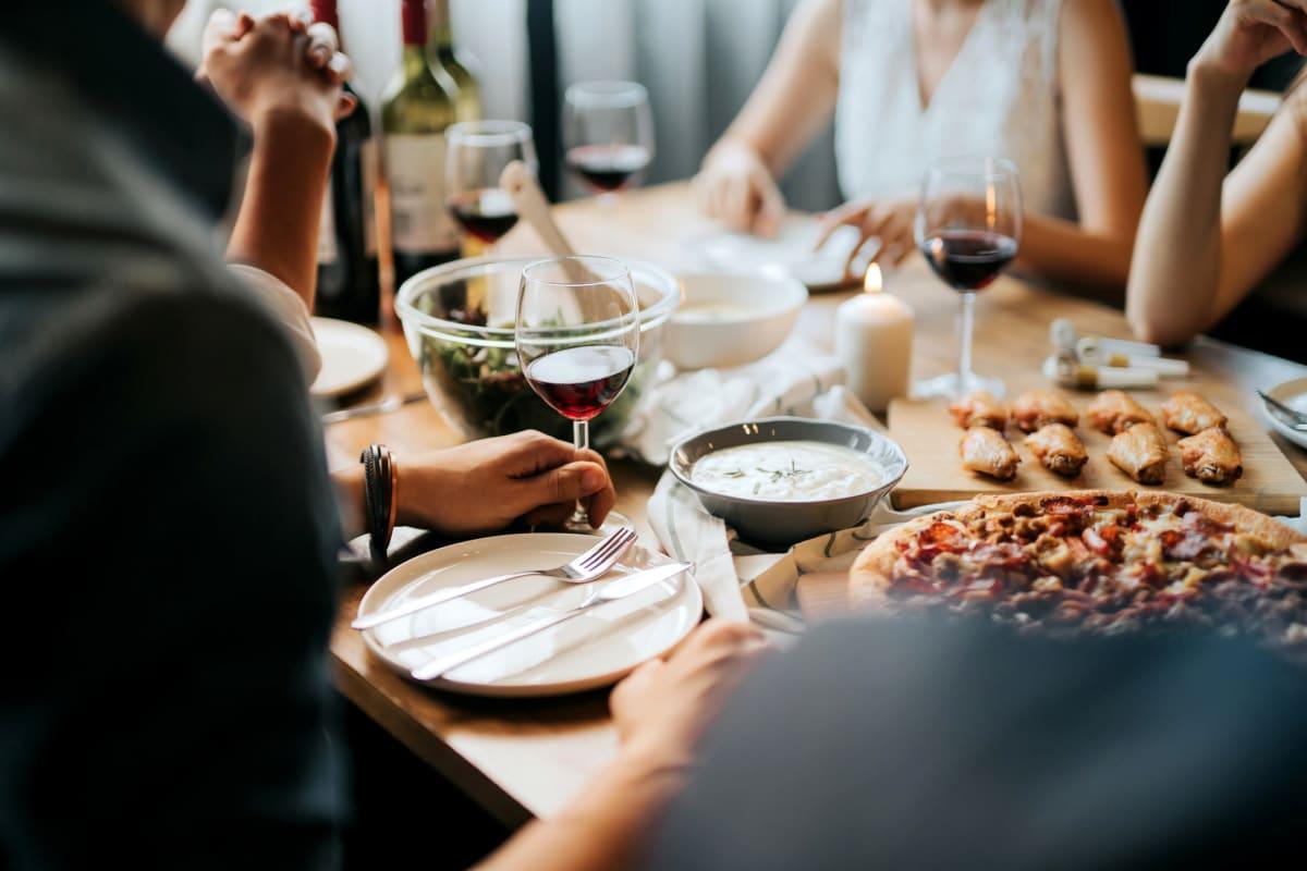 Residents drink wine and eating pizza near Optimist Lofts in Atlanta, Georgia
