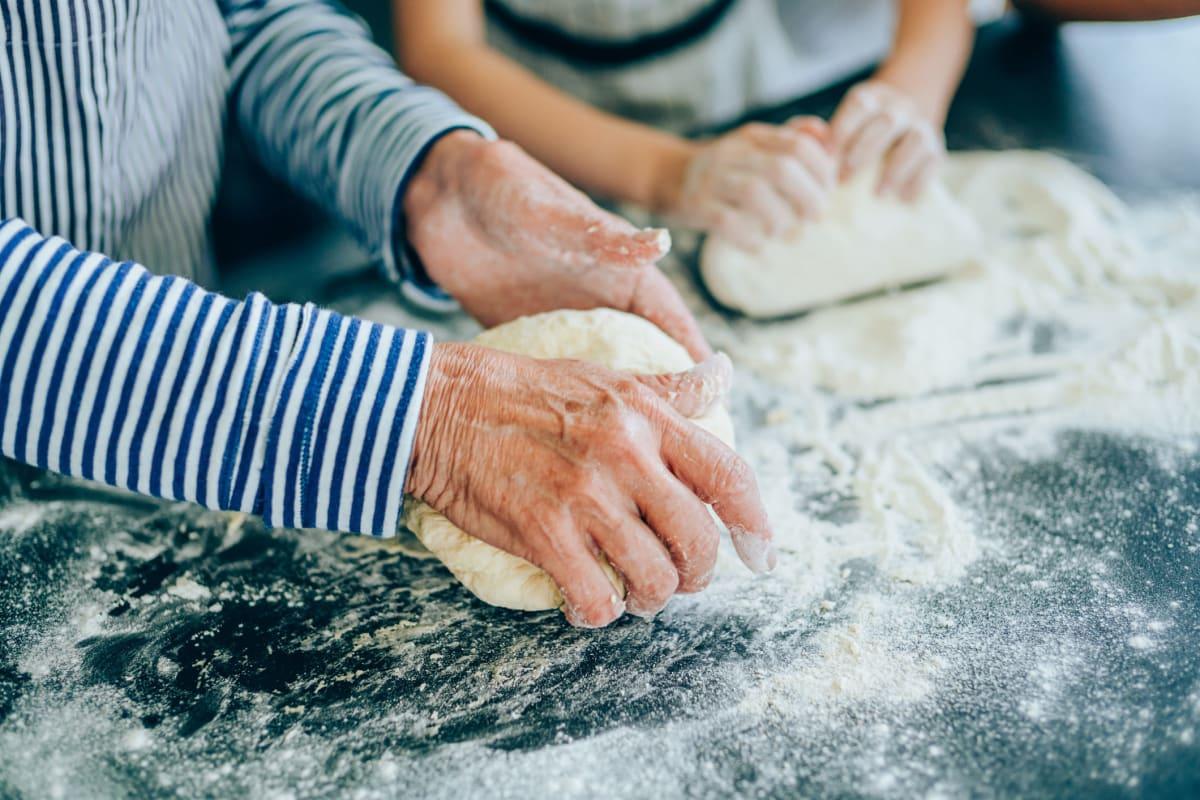 Two people kneading dough at Oxford Villa Active Senior Apartments in Wichita, Kansas