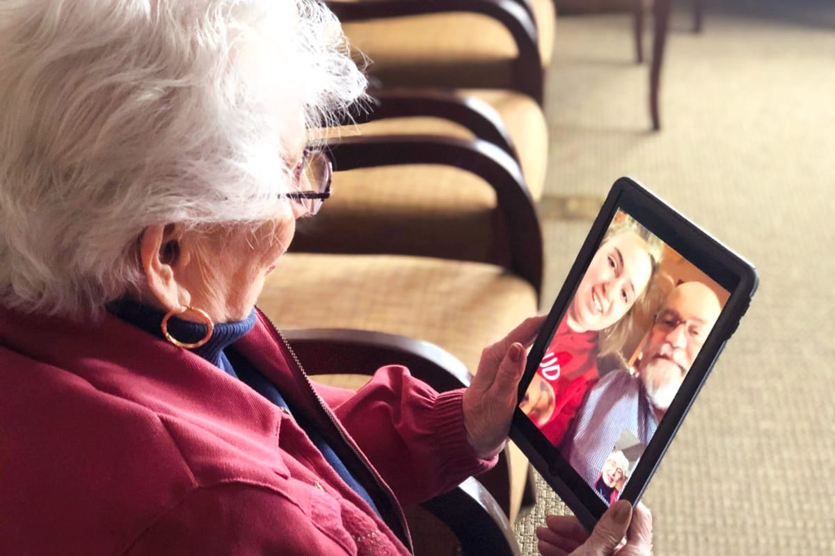 A resident using a tablet at Glen Carr House Memory Care in Derby, Kansas