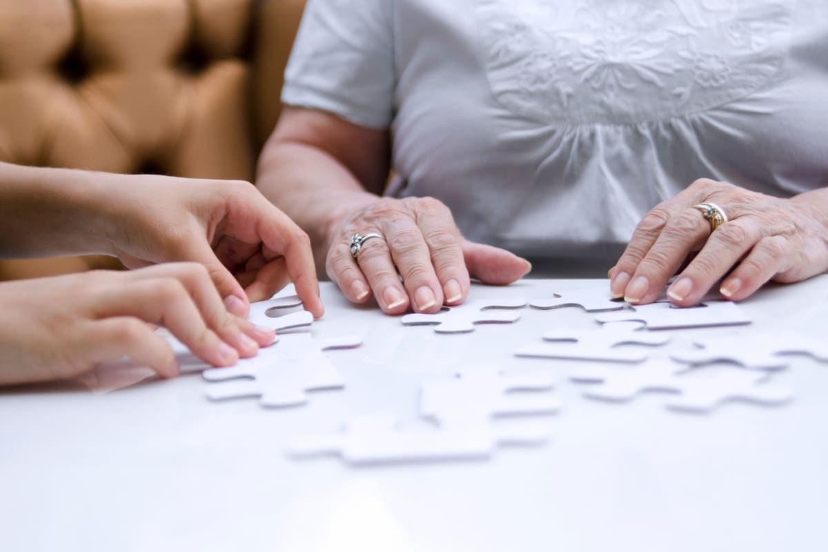 Residents playing a game together at Oxford Glen Memory Care at Sachse in Sachse, Texas