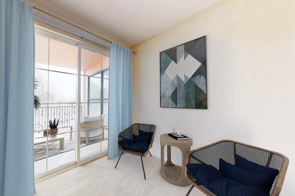 Luxury apartment with plush carpet and balcony with views of the marina at The Villa at Marina Harbor in Marina del Rey, California