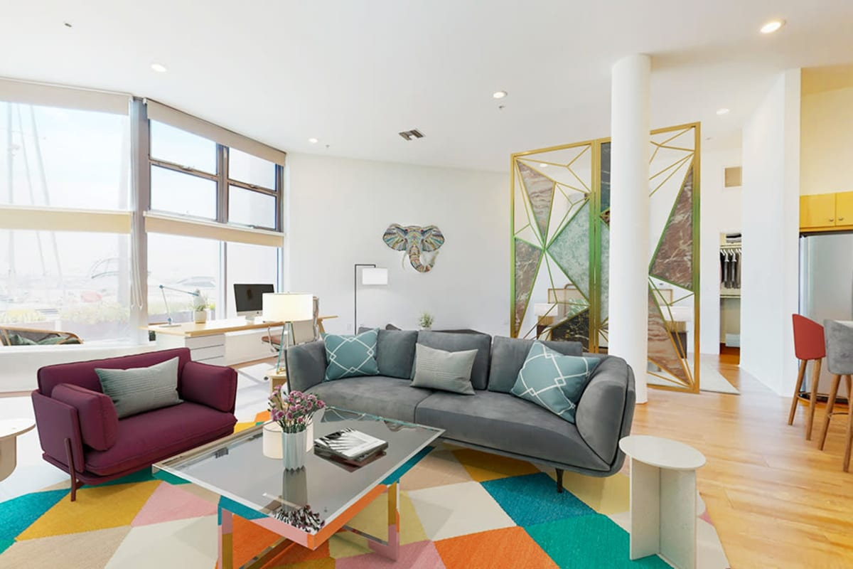 Spacious loft apartment with open-concept living room and work space, and hardwood floors at Esprit Marina del Rey in Marina Del Rey, California