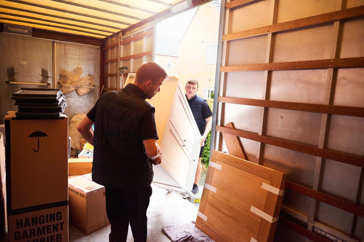 Two customers moving furniture near Red Dot Storage in Boulder, Colorado