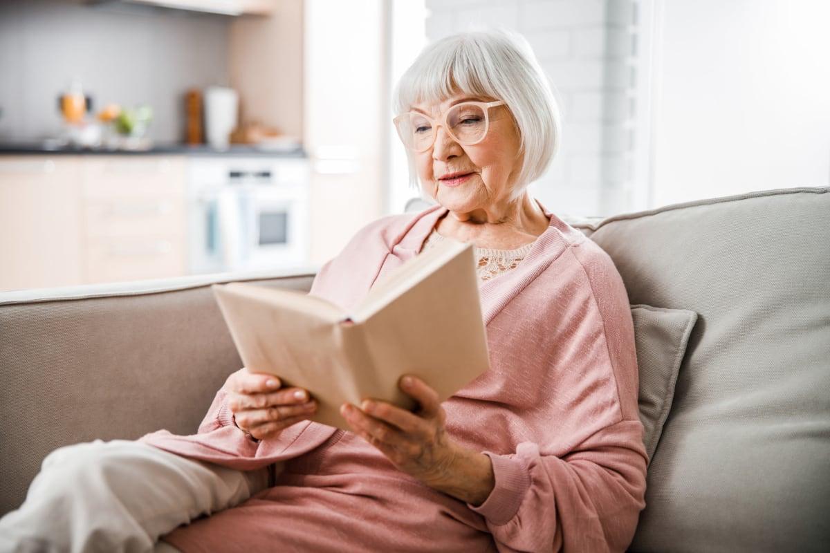 Resident reading a book at Alderbrook Village in Arkansas City, Kansas