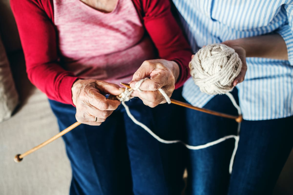 Two people knitting at Creekside Village in Ponca City, Oklahoma