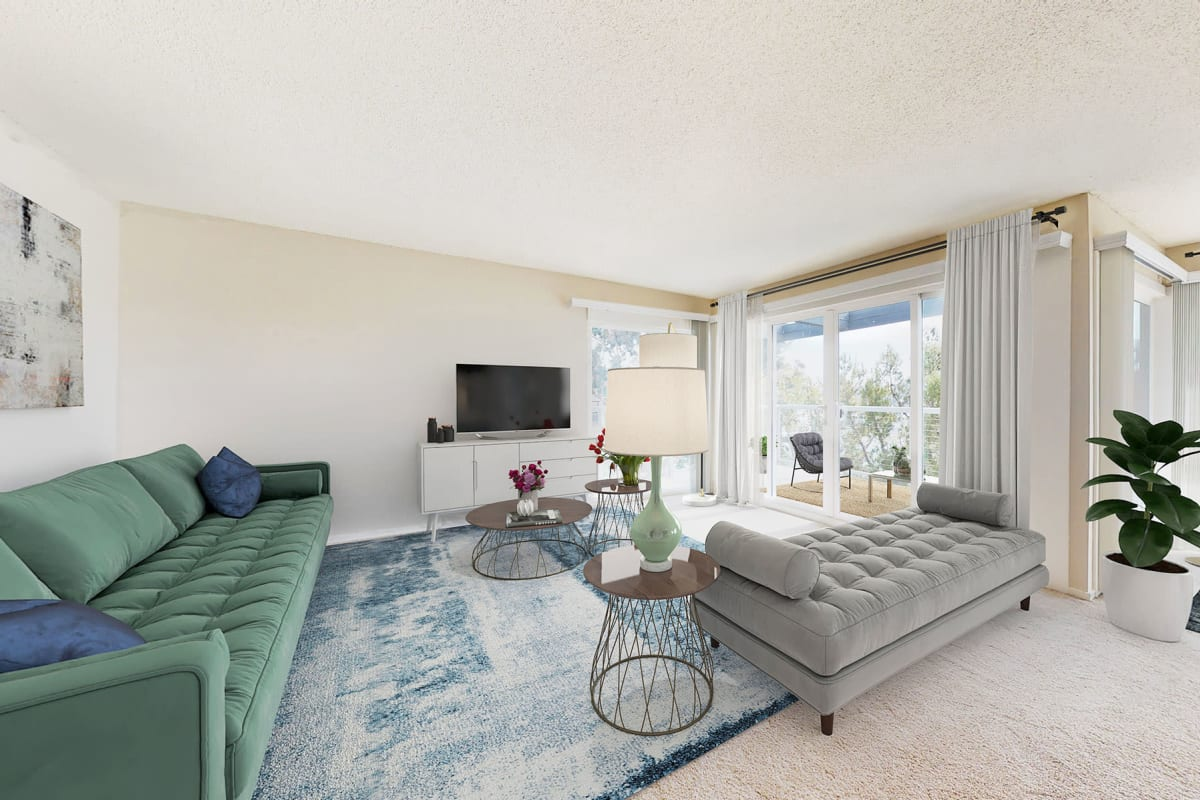 Spacious and well-furnished living area in an open-concept apartment home with waterfront views at The Tides at Marina Harbor in Marina Del Rey, California