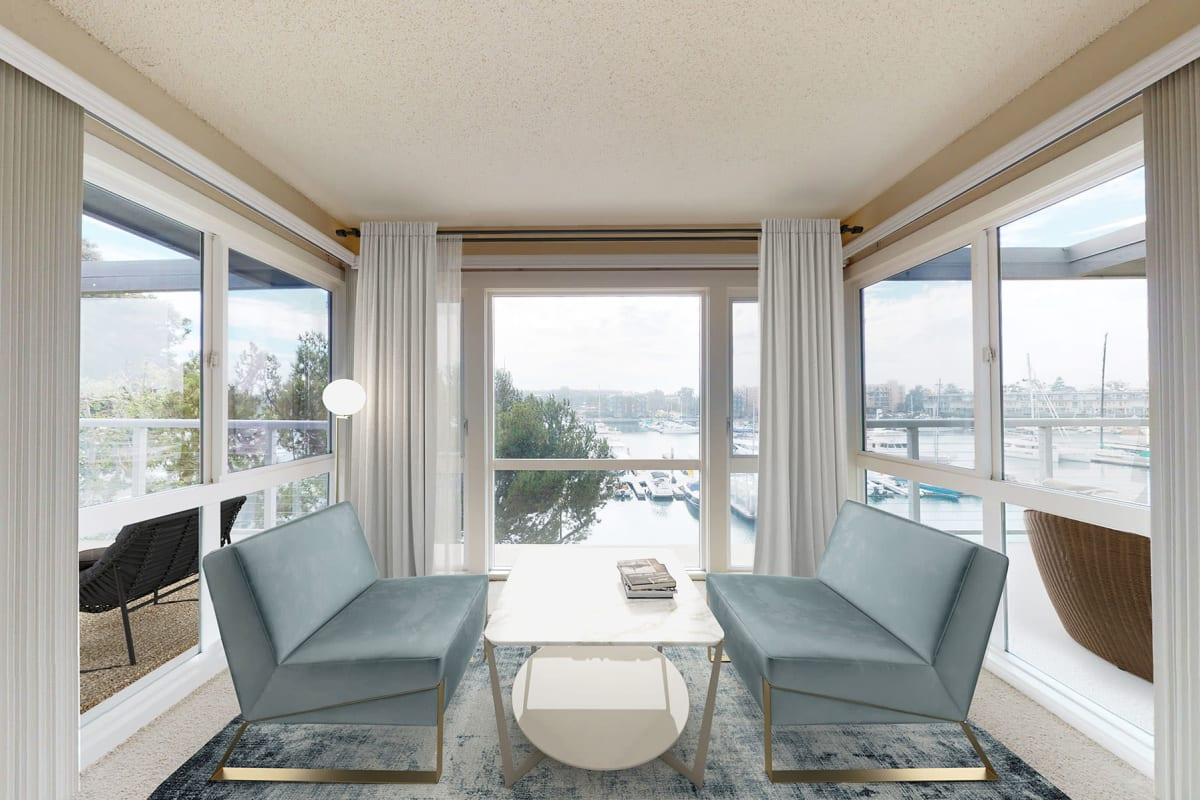 Seating area inside spacious apartment home with expansive waterfront views of the marina at The Tides at Marina Harbor in Marina Del Rey, California