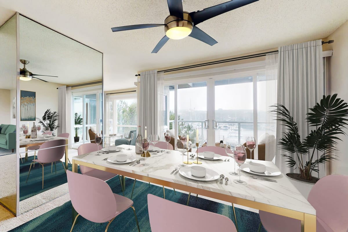 Open concept dining room inside spacious apartment home with waterfront views of the marina at The Tides at Marina Harbor in Marina Del Rey, California