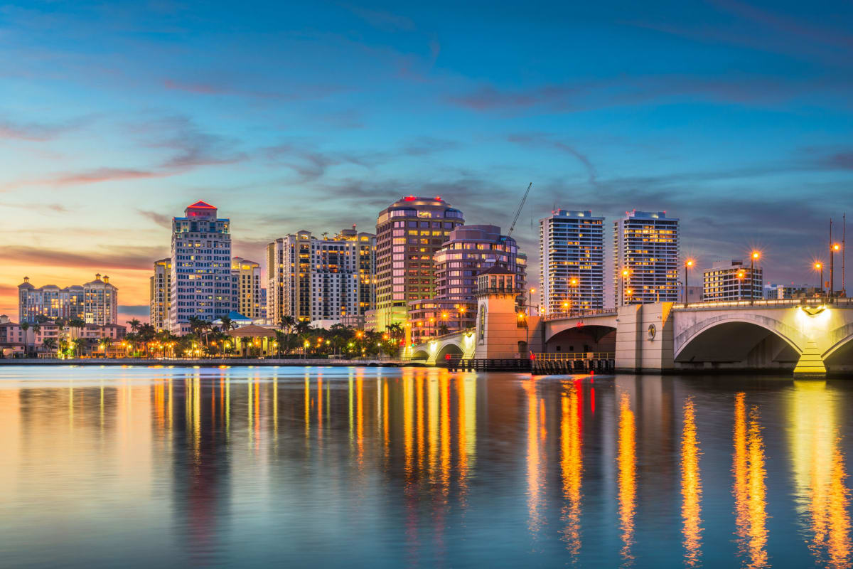 Evening view of the city skyline from across the Intracoastal Waterway near Solera at City Centre in Palm Beach Gardens, Florida