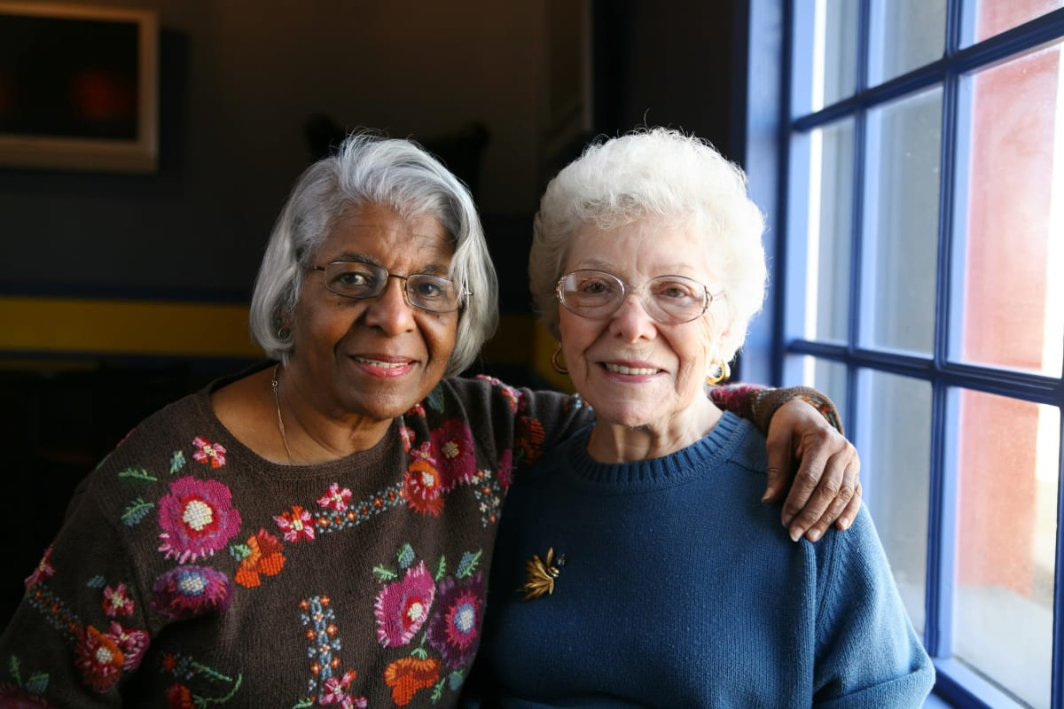Two residents smiling at Canoe Brook Assisted Living in Ardmore, Oklahoma