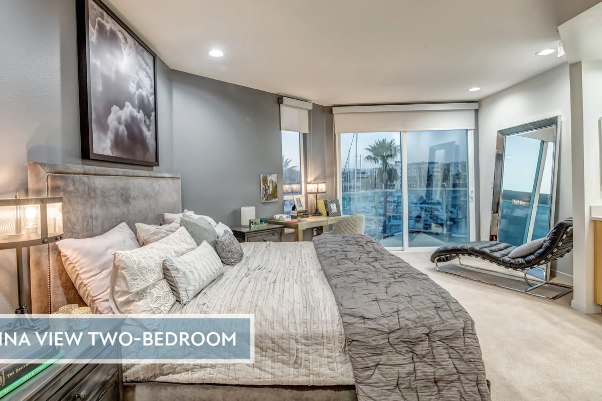 Very well-furnished model home's bedroom at Esprit Marina del Rey in Marina del Rey, California