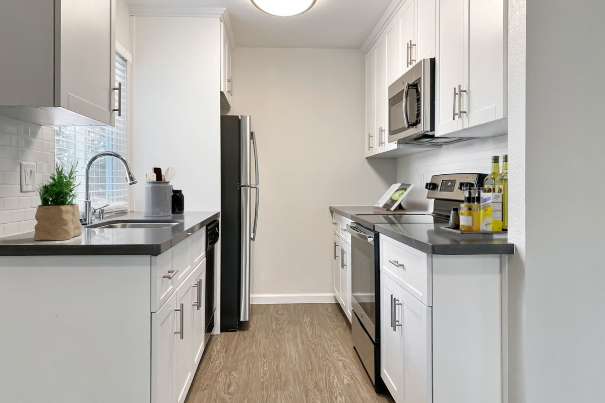 Granite countertops and stainless-steel appliances in a model home at Valley Plaza Villages in Pleasanton, California