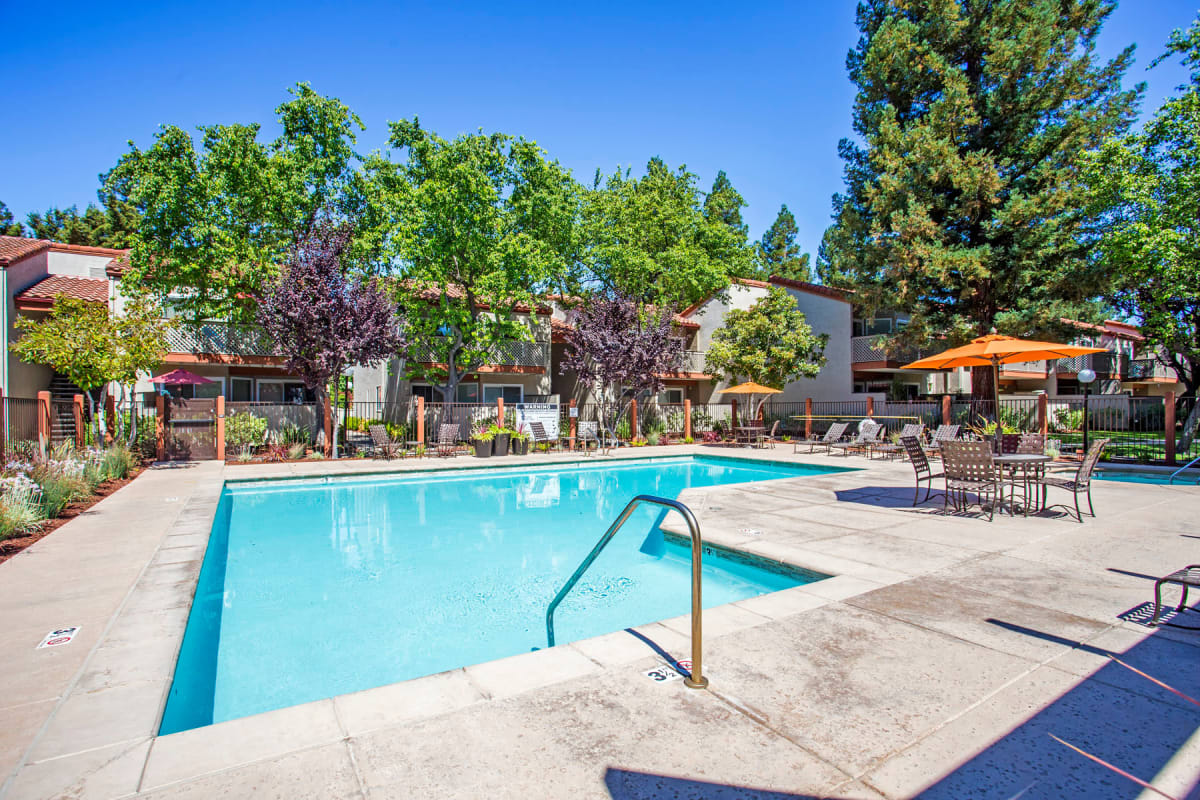 Resort-style swimming pool on a beautiful day at Valley Plaza Villages in Pleasanton, California