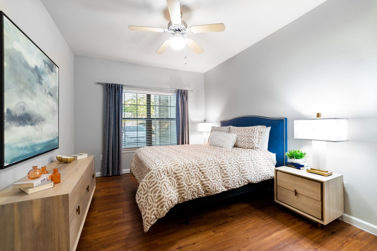 Bedroom with wood style flooring at Marquis Parkside in Austin, Texas
