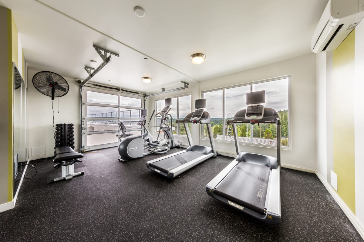 Fully equipped fitness center at Marq West Seattle in Seattle, Washington