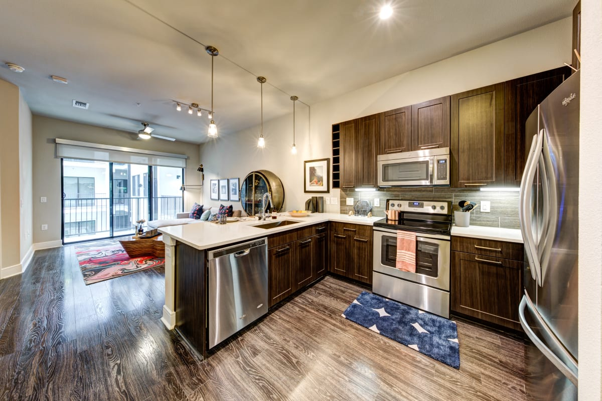 Kitchen with stainless steel appliances at Water Marq in Austin, Texas