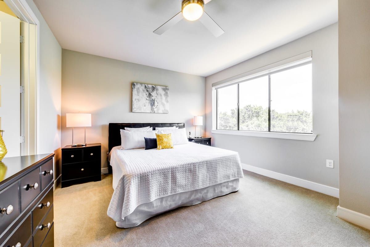 Bedroom with large windows at Water Marq in Austin, Texas