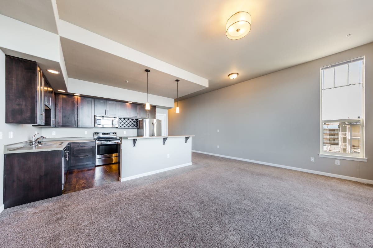 Carpeted living room at Copperline at Point Ruston in Tacoma, Washington