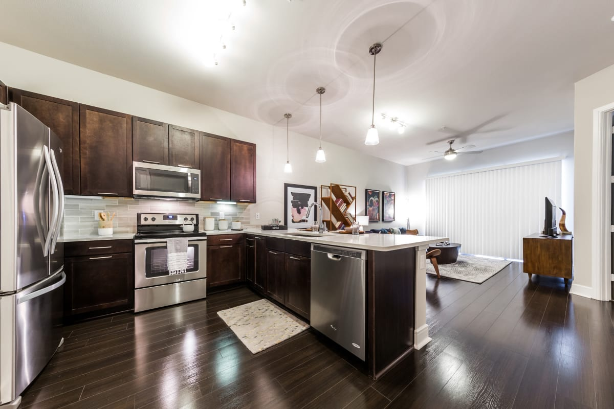 Kitchen with stainless steel appliances at Marq 31 in Houston, Texas