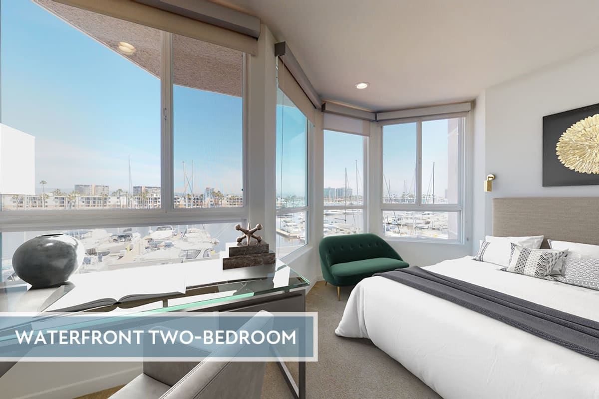 Bedroom with large windows and view of the marina channel front at Esprit Marina del Rey in Marina del Rey, California
