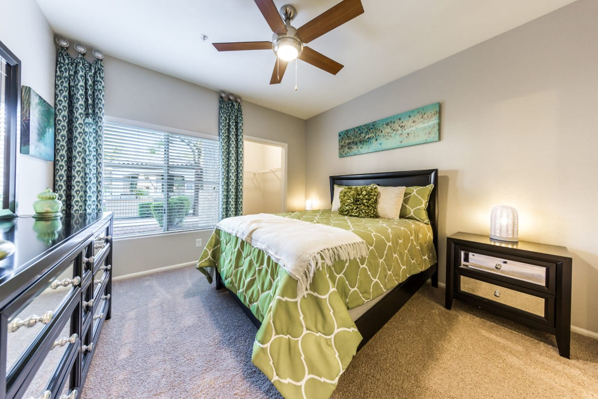 Bedroom with ceiling fan at Marquis at Arrowhead in Peoria, Arizona