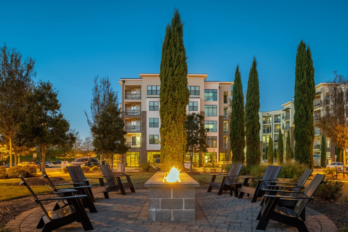 Outdoor fire pit with surrounding chairs at Marq at Crabtree in Raleigh, North Carolina