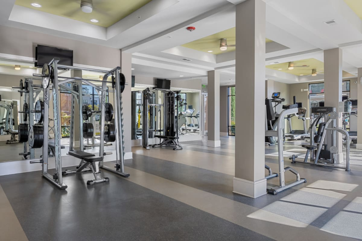 Assisted bench press and weight machines in fitness room at Marq at Crabtree in Raleigh, North Carolina