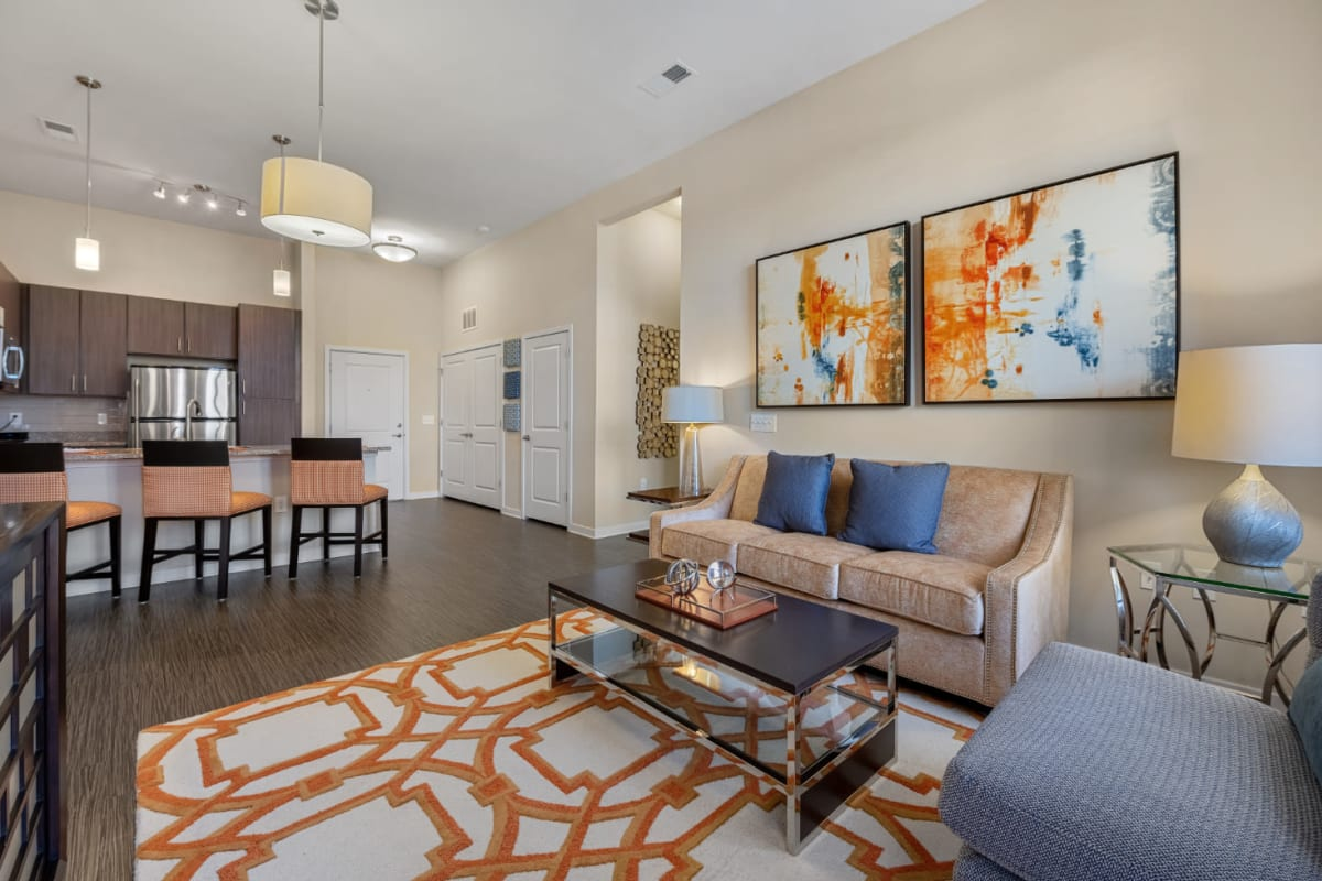 Modern and bright open living room and kitchen at Marq at Crabtree in Raleigh, North Carolina