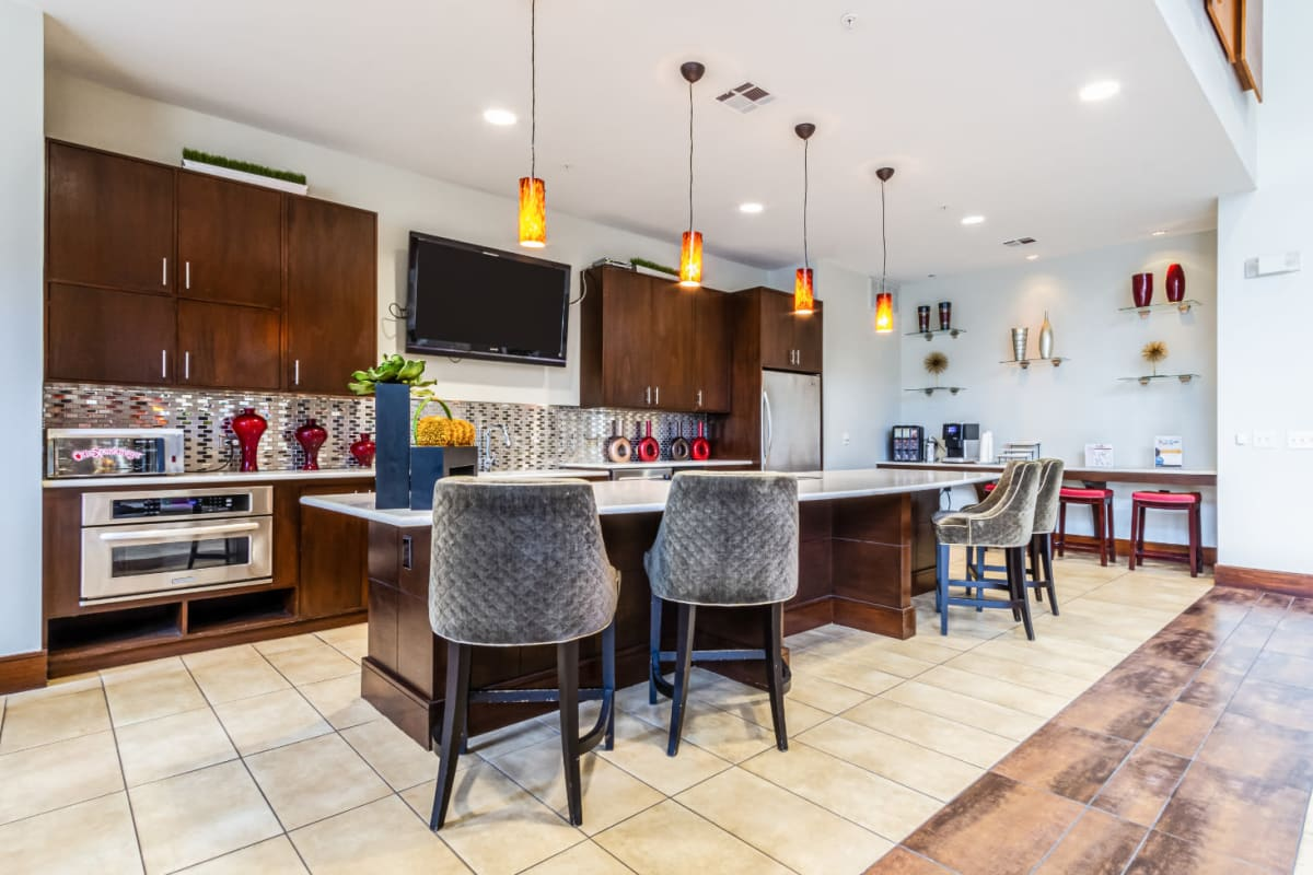 Community clubhouse kitchen with counter and counter stools at The Marq on Voss in Houston, Texas