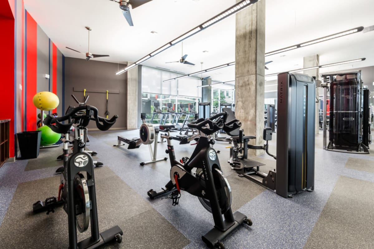 Spin bikes and row machine in fully equipped fitness room at Marq on Burnet in Austin, Texas