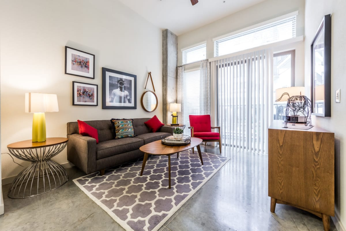 Bright living room with large sofa and modern furnishings at Marq on Burnet in Austin, Texas