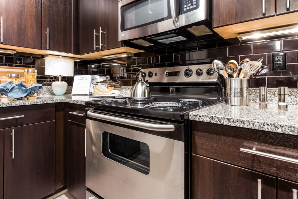 Stainless steel microwave and oven, and granite countertops at Marquis Midtown District in Atlanta, Georgia