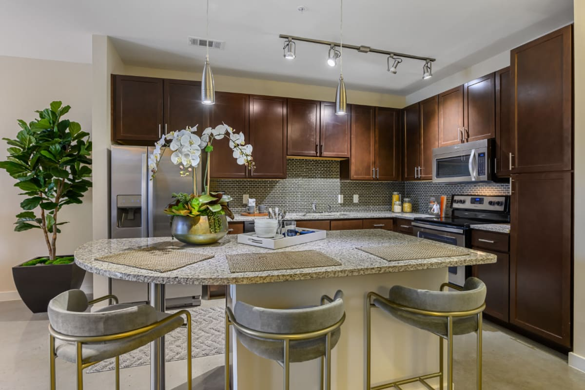 Kitchen island granite counter with stool chairs at The 704 in Austin, Texas