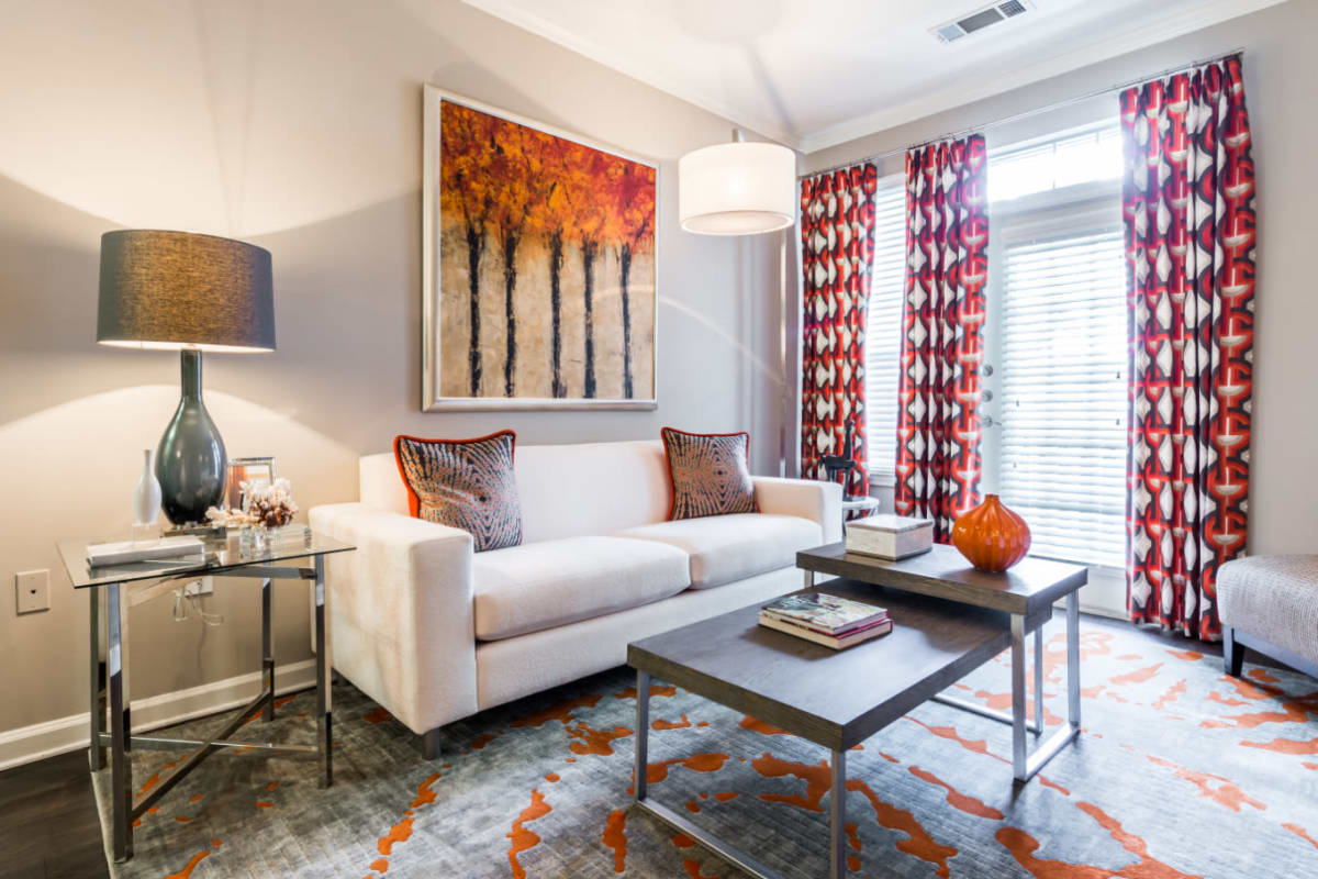 Colorful living room with modern furnishings and wood flooring at The Marq at Brookhaven in Atlanta, Georgia