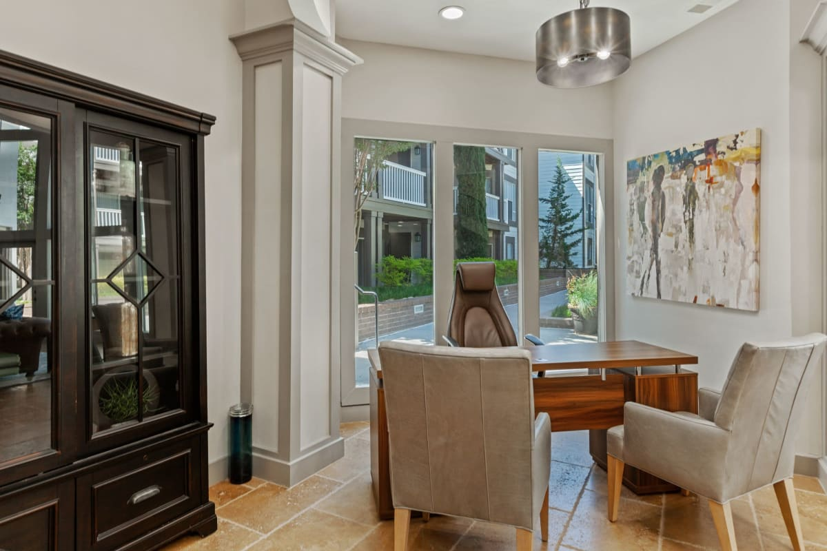 Nice dining area with a view to the patio at 45Eighty Dunwoody Apartment Homes in Dunwoody, Georgia