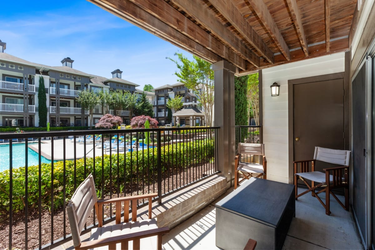 Awesome private patio with a view of the pool at 45Eighty Dunwoody Apartment Homes in Dunwoody, Georgia