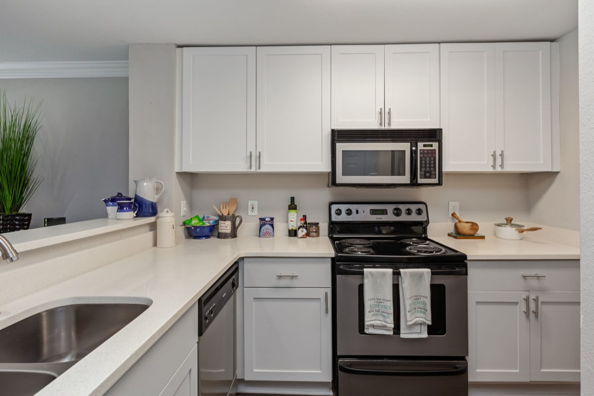Large kitchen area with stainless steel appliances at 45Eighty Dunwoody Apartment Homes in Dunwoody, Georgia
