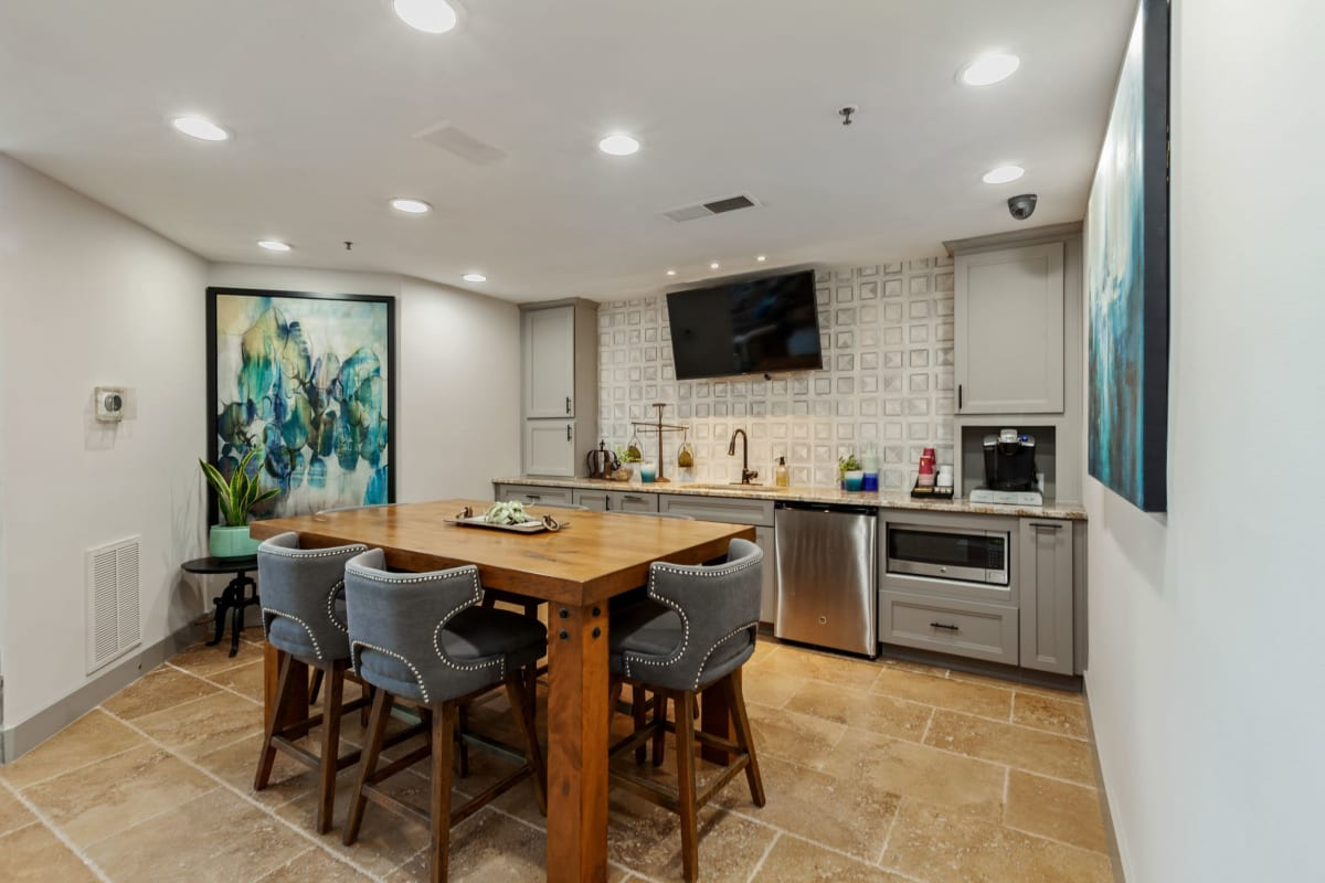 Large kitchen and dining area with great tile flooring at 45Eighty Dunwoody Apartment Homes in Dunwoody, Georgia
