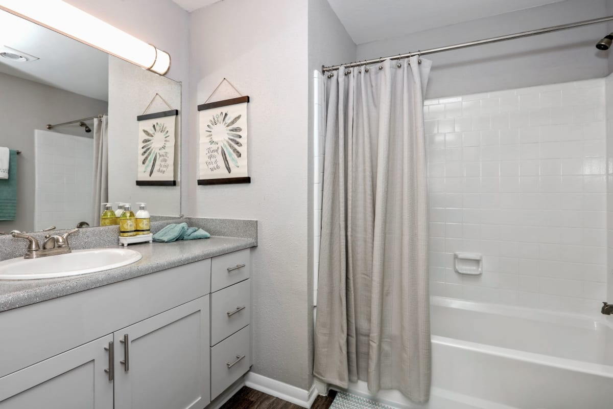 Large bathroom with bath and shower combined at 45Eighty Dunwoody Apartment Homes in Dunwoody, Georgia