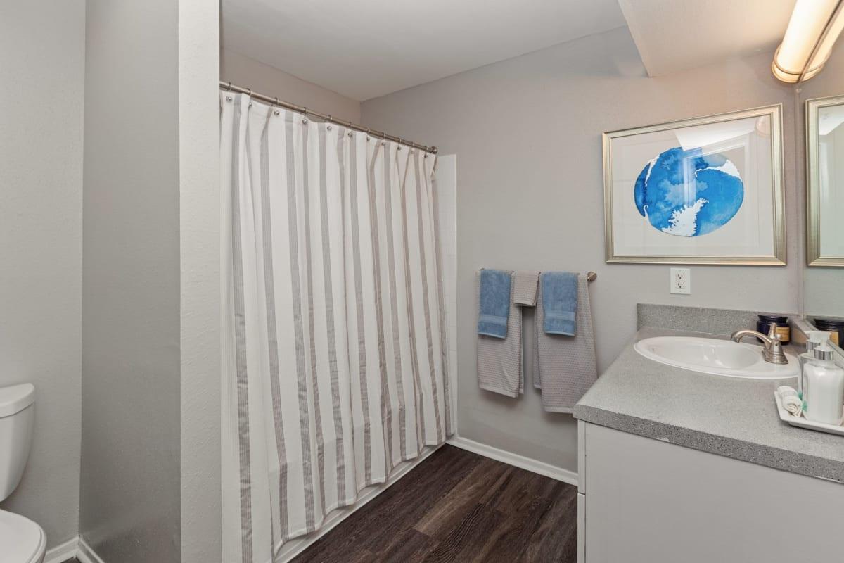 Nice wood flooring in the bathroom at 45Eighty Dunwoody Apartment Homes in Dunwoody, Georgia