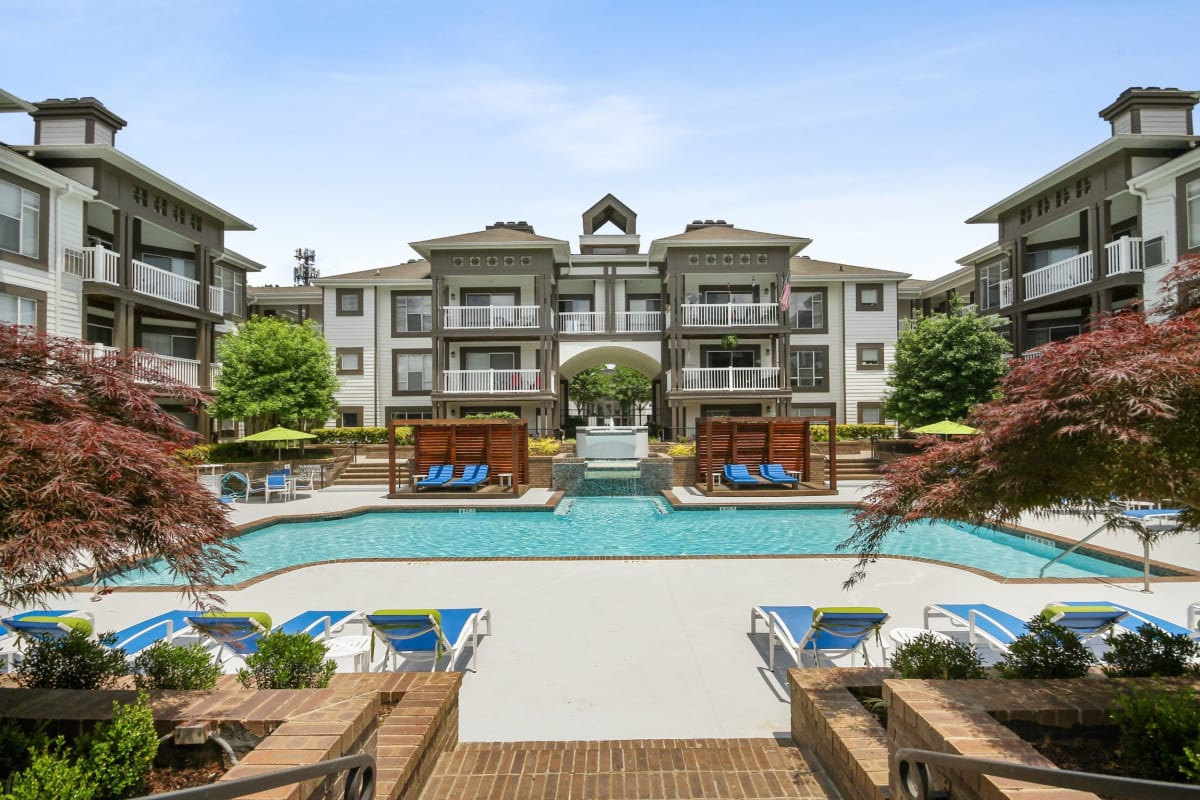 Beautiful resort style swimming pool with tons of lounge chairs at 45Eighty Dunwoody Apartment Homes in Dunwoody, Georgia