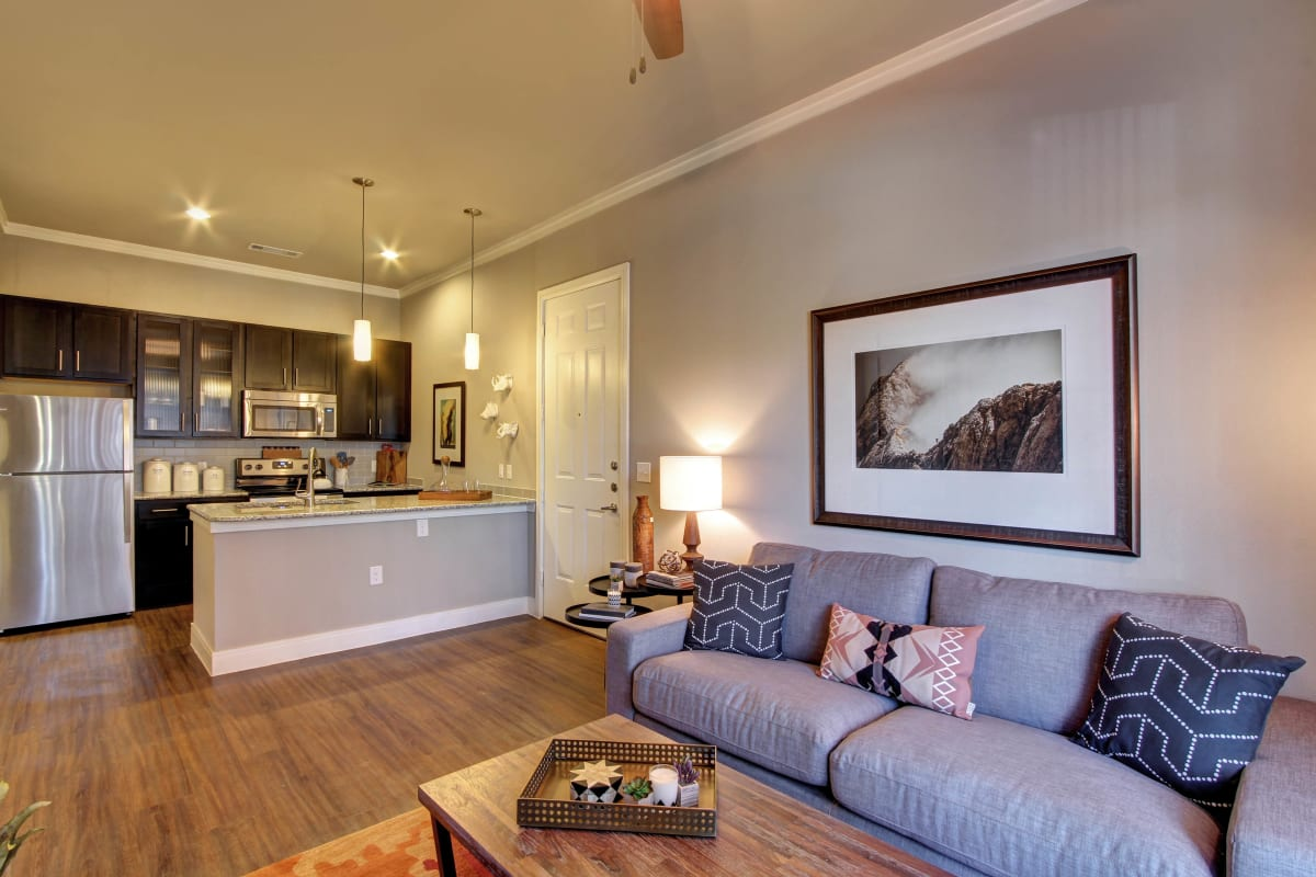 Open floor plan with wood flooring at Marquis at Barton Trails in Austin, Texas